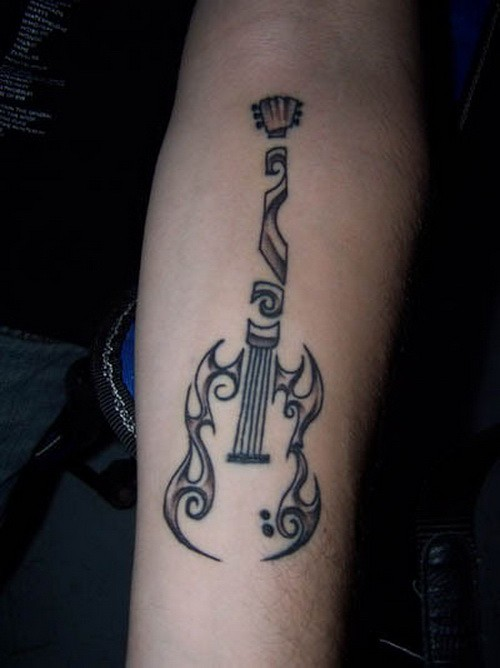Unusual tribal black ink guitar tattoo on forearm for Black tribal tattoo ink