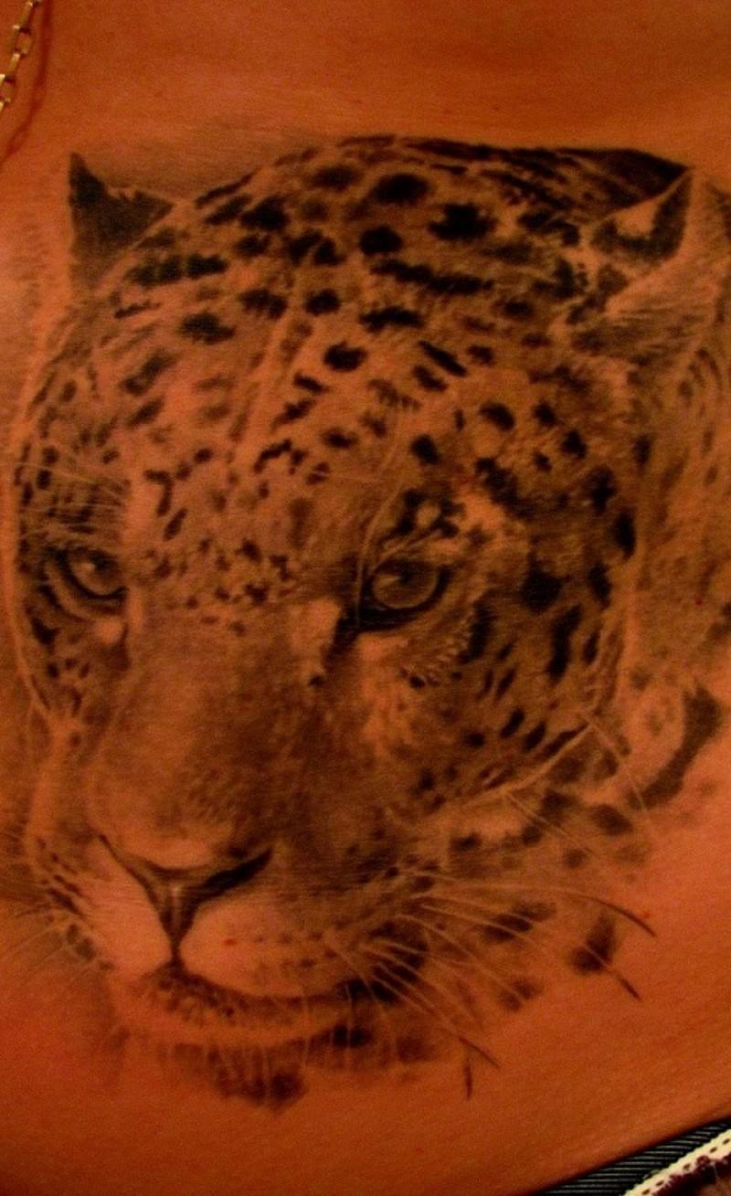 Very realistic detailed and painted little black and white animal leopard tattoo on waist