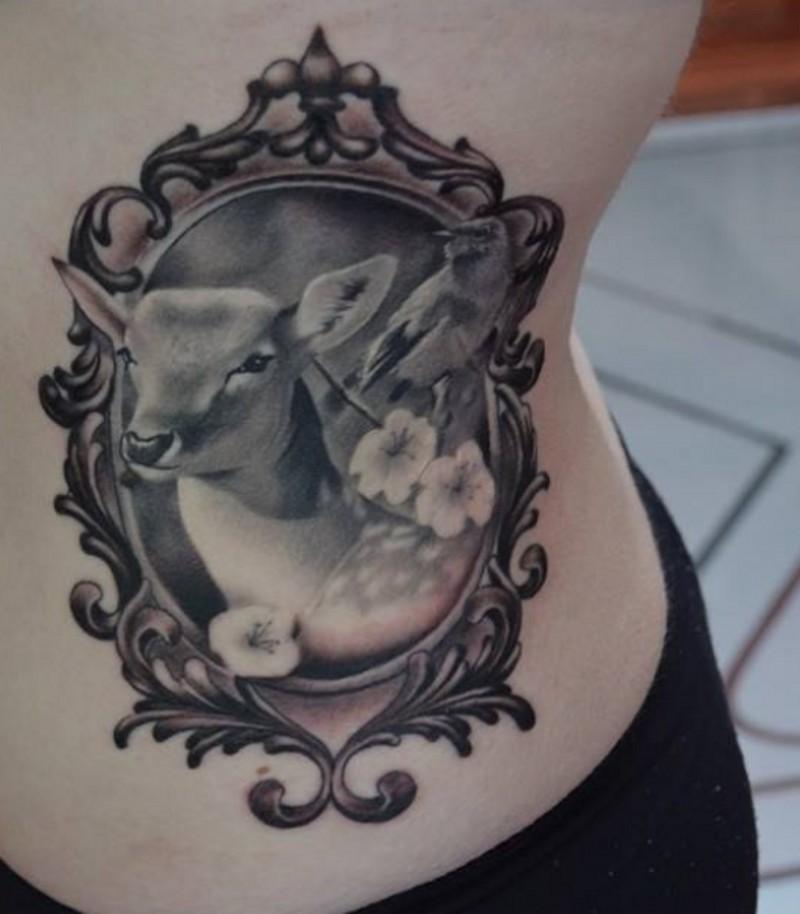 Very realistic detailed medium black and white animal deer portrait tattoo on waist