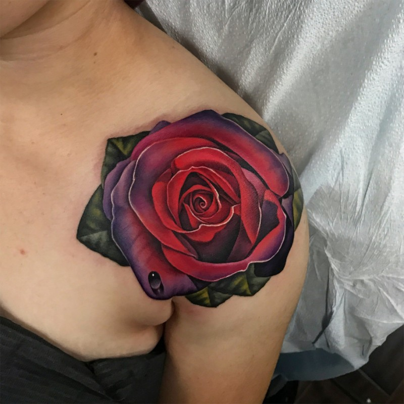 Very realistic rose tattoo on shoulder