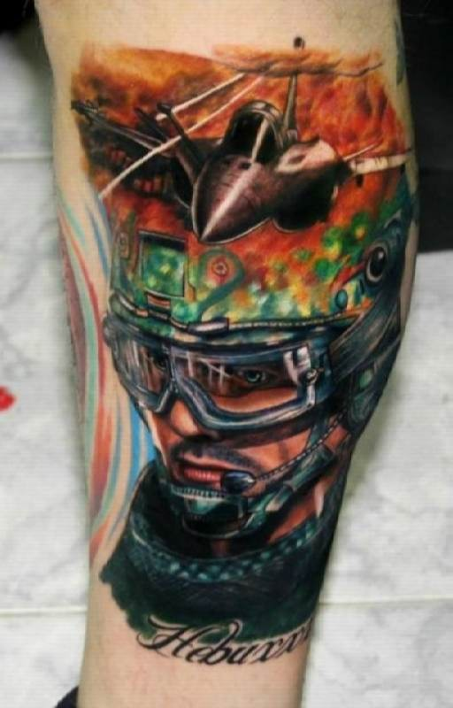 Video game style colored arm tattoo of pilot portrait with modern plane