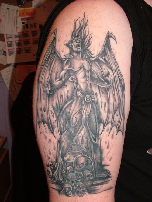 Video games like large gargoyle warrior tattoo on upper arm