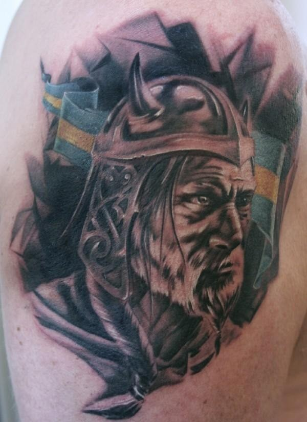 Viking head and a flag tattoo on shoulder for Small viking tattoos
