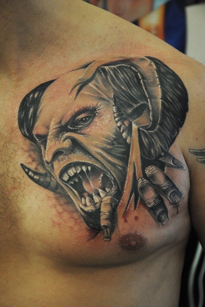 Vintage horror style detailed chest tattoo of monster devil head