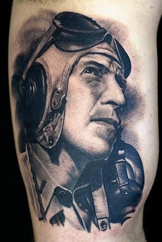 Vintage portrait style detailed biceps tattoo of WW2 pilot