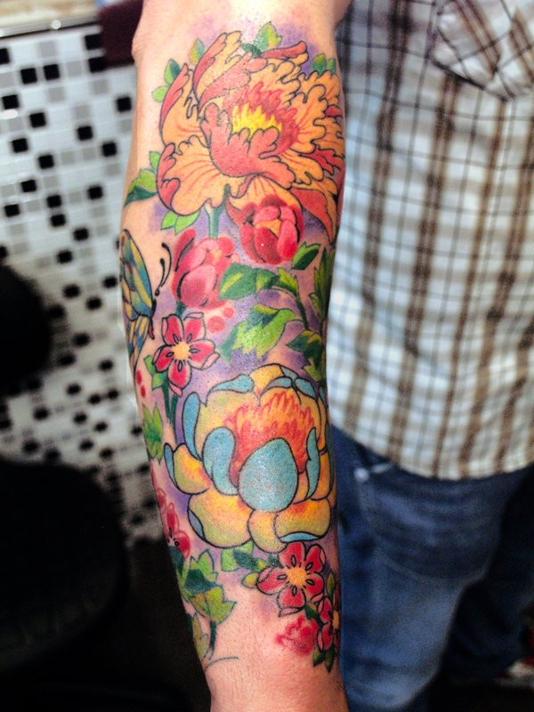 Vivid-colored japanese flower tattoo on arm