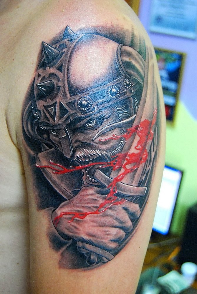 Warrior and blooded sword tattoo on shoulder