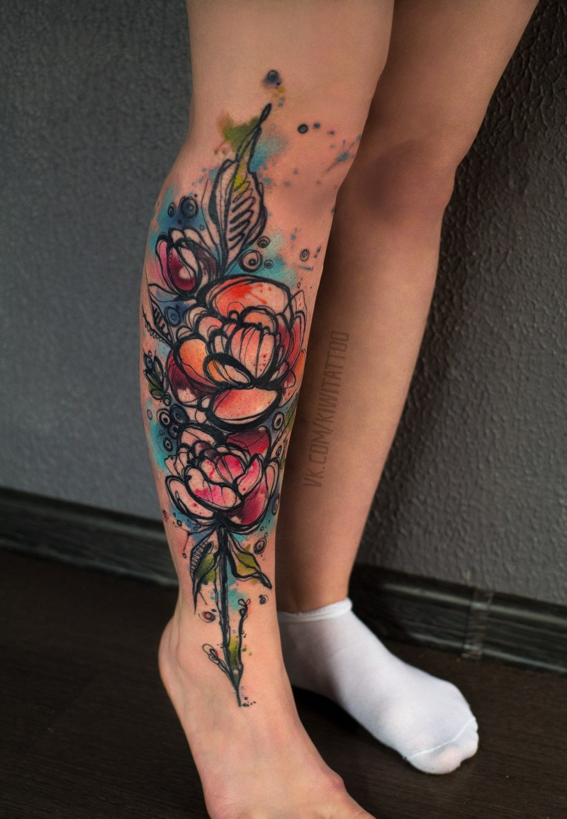 Watercollor flower tattoo on leg