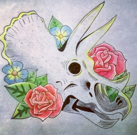 White dinosaur skull and colorful flowers tattoo design