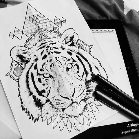 White realistic tiger on mandala and geometric figures background tattoo design