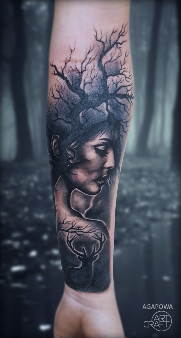 Womans head and dryed tree tattoo on wrist