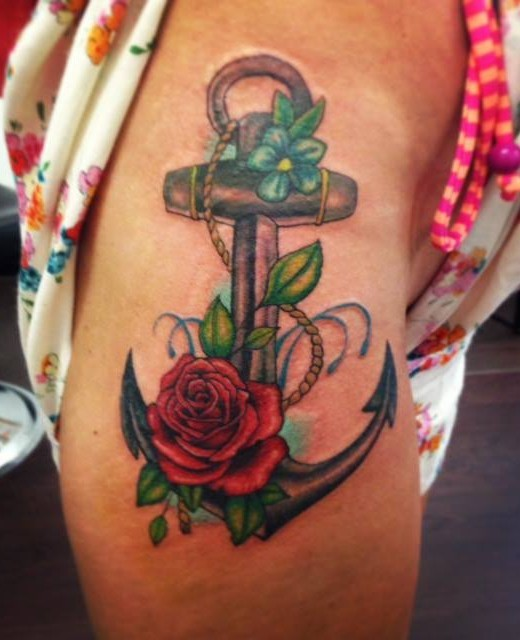 Wonderful colored iron anchor with flowers tattoo on thigh