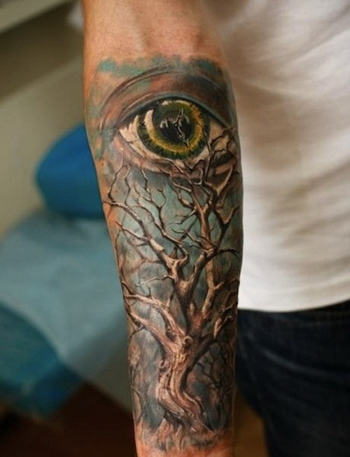 Wonderful colorful tree and eye on blue background tattoo sleeve on forearm