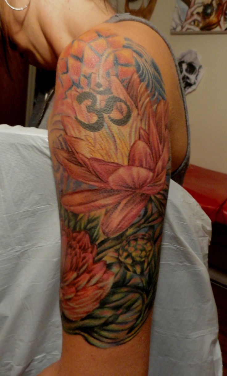 Wonderful japanese flowers with sign tattoo on upper arm