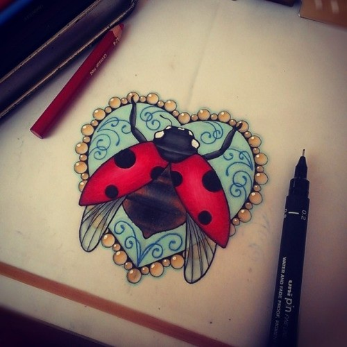 Wonderful ladybug on blue heart decorated with curls and for Ladybug heart tattoos