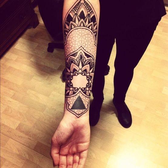 Wonderful ornamented tattoo on forearm