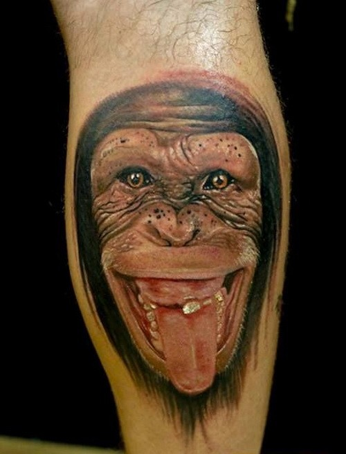 Wonderful realistic chimpanzee showing a tongue tattoo on arm