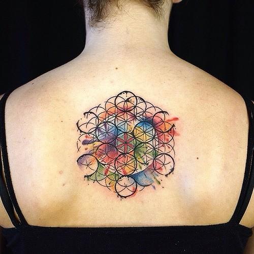 Wonderful vivid-colored flower of life tattoo on back