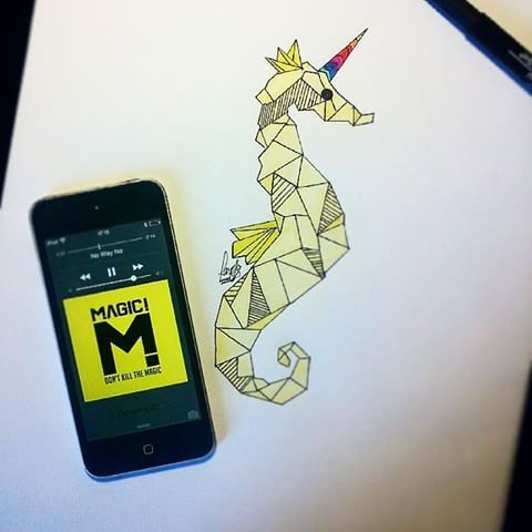 Yellow geometric seahorse with rainbow horn tattoo design