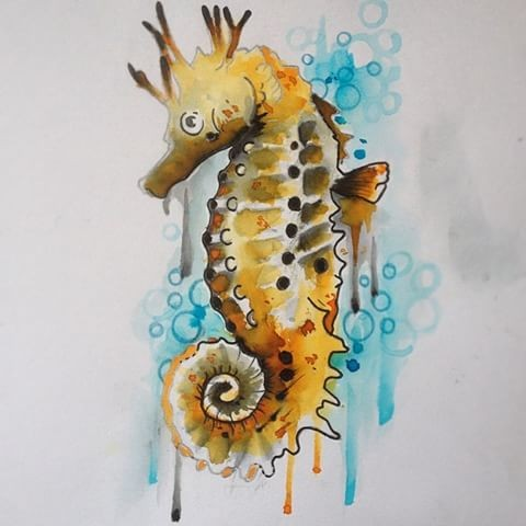 Yellow horned seahorse on blue smudged watercolor background tattoo design