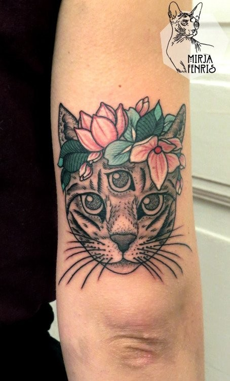 Mysterious colored arm tattoo of cat head with flowers