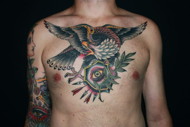 Old school colored chest tattoo of eagle with eye and arrows