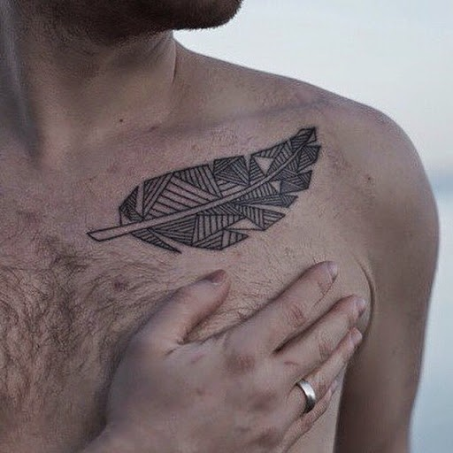 Abstract gray-ink tribal feather tattoos for men on chest