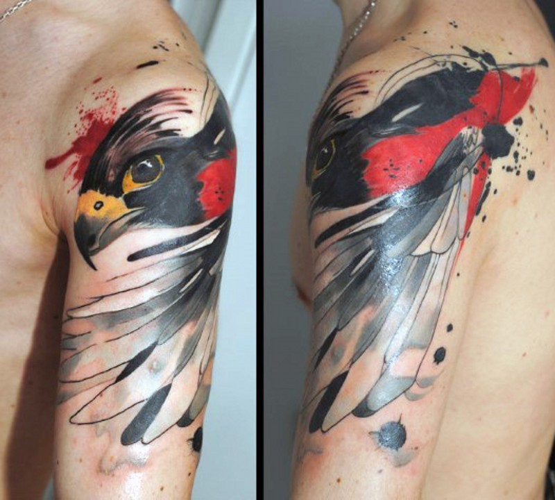 Abstract painted colored shoulder tattoo of eagle