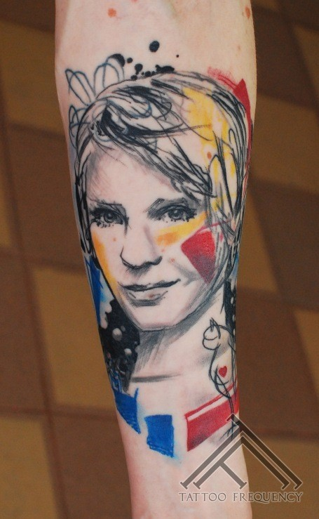Abstract style beautiful looking forearm tattoo of woman portrait