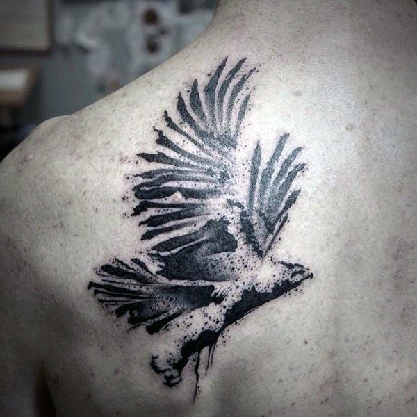 Abstract style black and white eagle tattoo on scapular