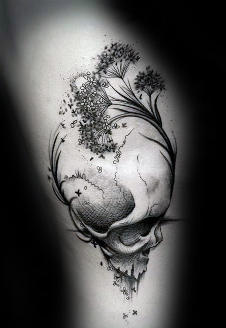 Abstract style black and white human skull with plants tattoo