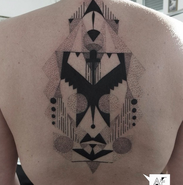 Abstract style black and white whole back tattoo of various ornaments