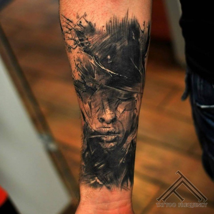 Abstract style black ink forearm tattoo of woman face with crows