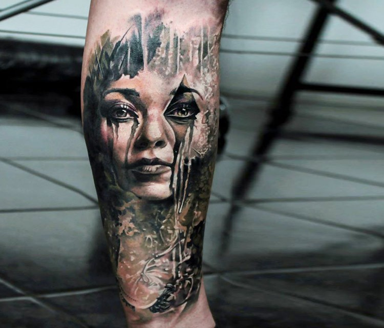 Abstract style black ink leg tattoo of mystical woman