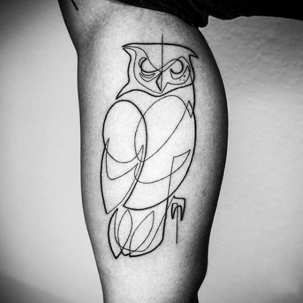 Abstract style black ink owl shaped tattoo on arm