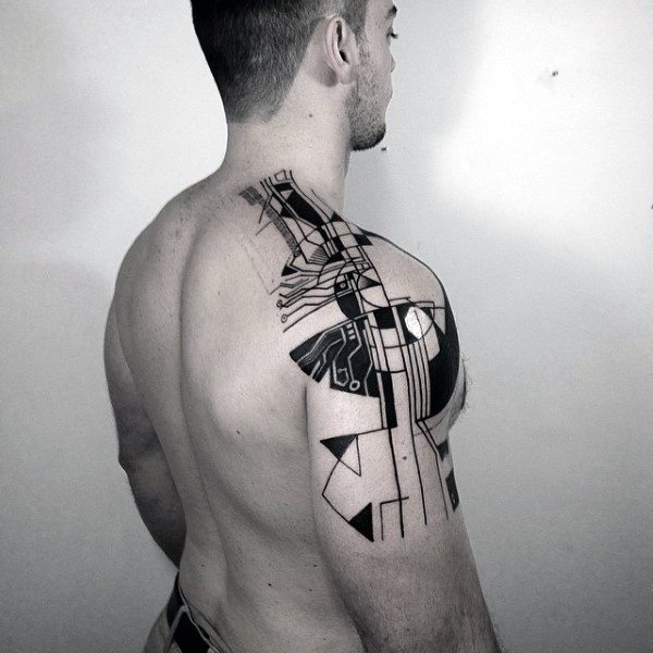 Abstract style black ink shoulder tattoo of various ornaments