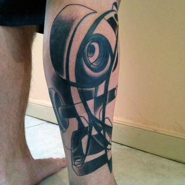 Abstract style black ink skateboard parts tattoo on leg