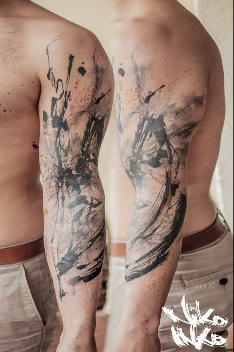 Abstract style black ink sleeve tattoo of various ornaments