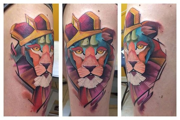 Abstract style cartoon like colored big king lion tattoo