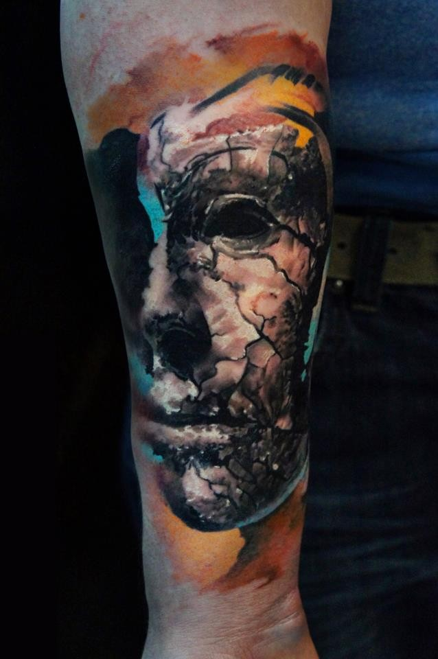 Abstract style colored arm tattoo of corrupted mask