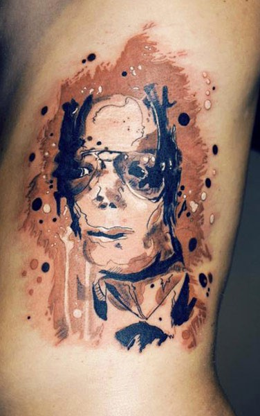 Abstract style colored arm tattoo of Michael Jackson