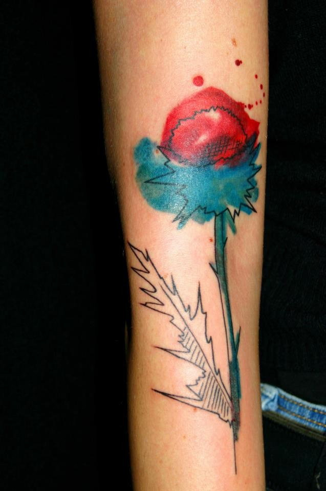 Abstract style colored arm tattoo of big flower