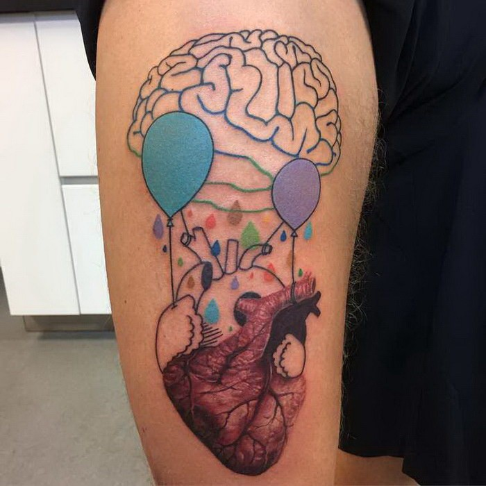 Abstract style colored arm tattoo of human heart with balloons and brain