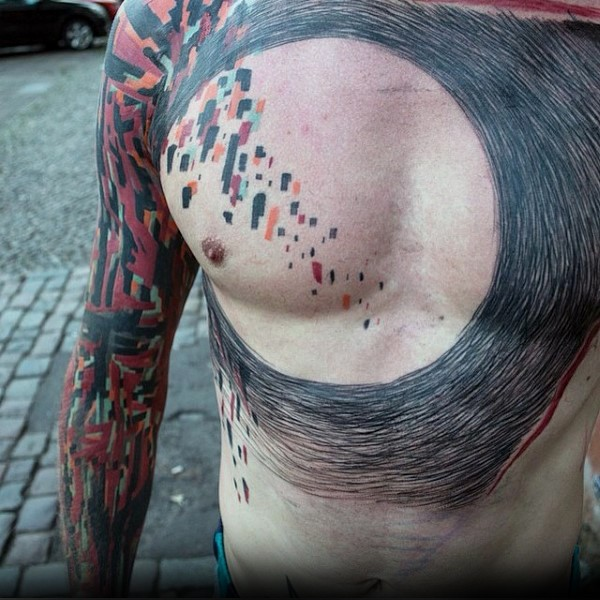 Abstract style colored chest and shoulder tattoo of various ornaments