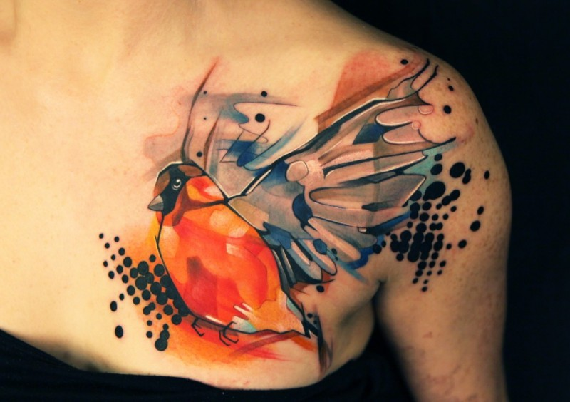 Abstract style colored chest tattoo of flying bird
