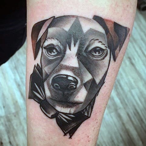Abstract style colored dog portrait tattoo on arm