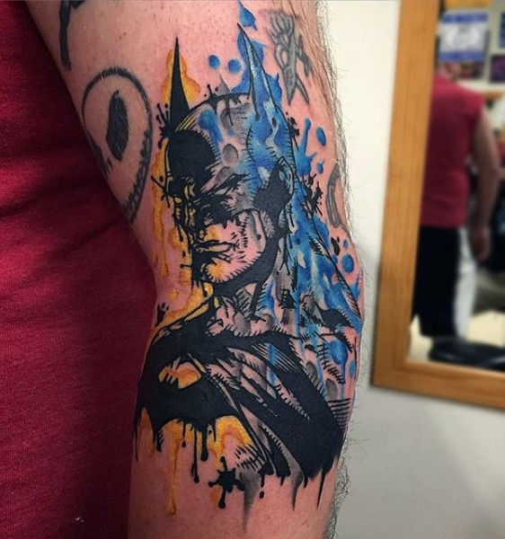 Abstract style colored elbow tattoo of Batman