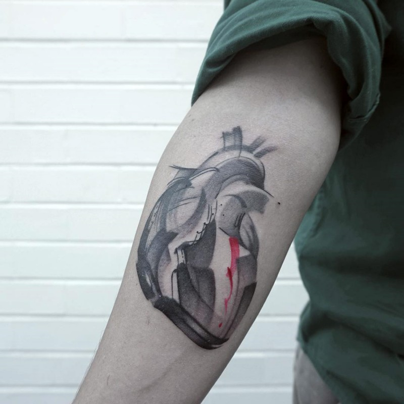 Abstract style colored forearm tattoo of human heart