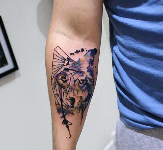 Abstract style colored forearm tattoo of wolf face