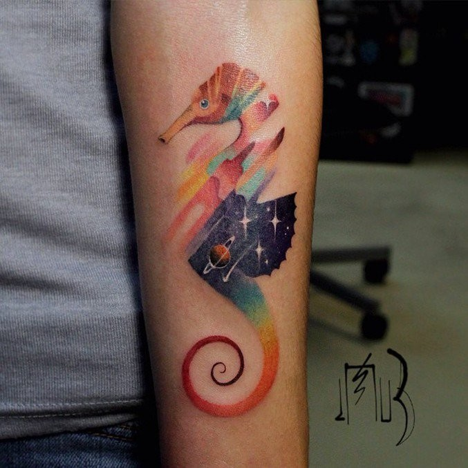 Abstract style colored forearm tattoo of seahorse with stars